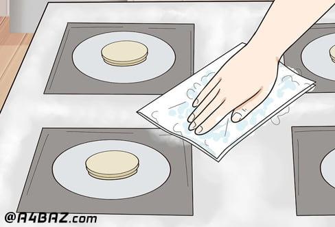 تمیز کردن صفحه اجاق گاز
