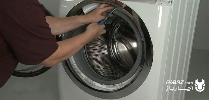 علل باز نشدن درب لباسشویی بوش